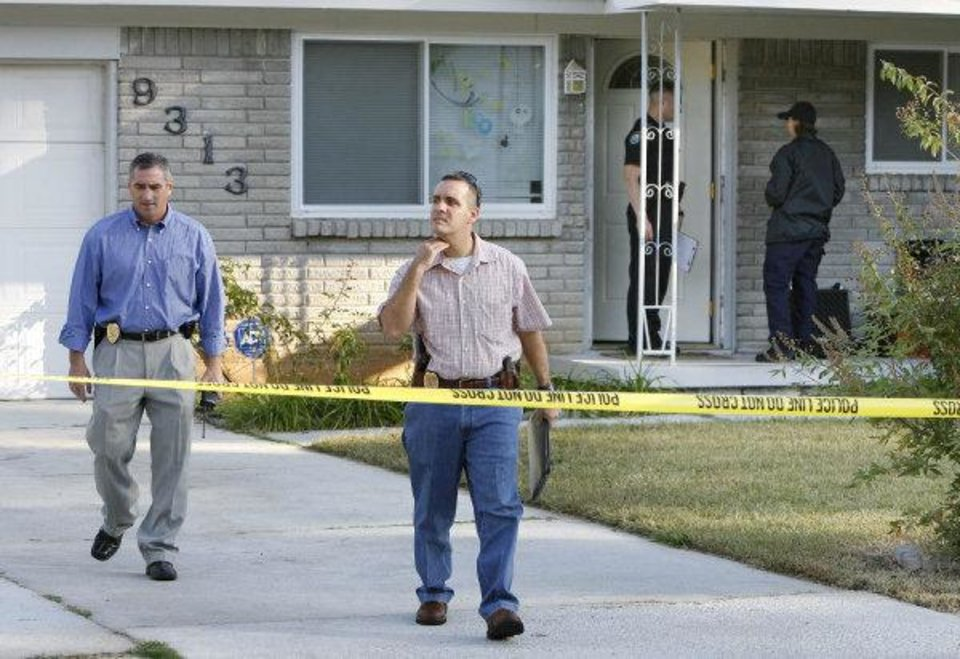Photo - Midwest City police investigate the scene of a home invasion and shooting  in Midwest City  A woman told police she shot two intruders who broke into her house. By Paul Hellstern, The Oklahoman ORG XMIT: KOD  PAUL HELLSTERN