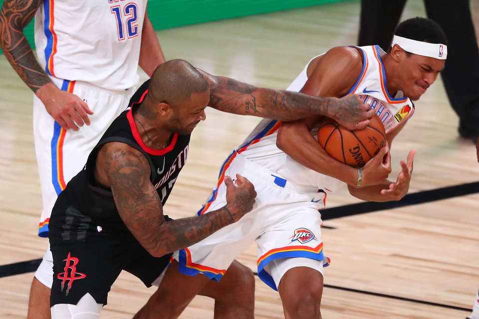 Photo -  Rockets forward P.J. Tucker (17) battles with Thunder rookie Darius Bazley (7) for a ball during the first half Wednesday. Bazley had six points, three rebounds and two blocks in 15 minutes. [Kim Klement/USA TODAY Sports]