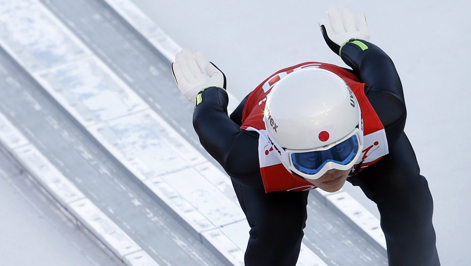 Photo - Japan's Sara Takanashi speeds down the track during a women's ski jumping training session at the 2014 Winter Olympics, Saturday, Feb. 8, 2014, in Krasnaya Polyana, Russia. (AP Photo/Matthias Schrader)