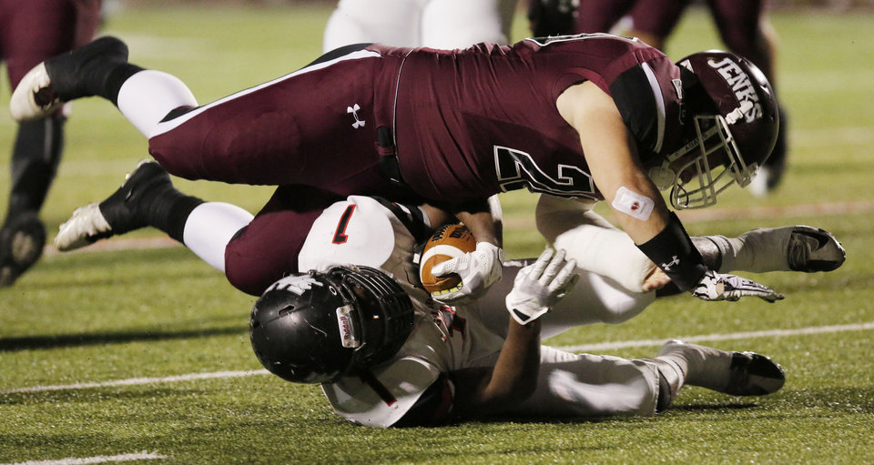 Photo - Jenks (20) Trent Taber flattens Westmoore's Kieron Hardrick (1) during the 6A high school playoff game between Westmoore and Jenks at Yukon High School Friday November 29, 2013. Photo by Doug Hoke, The Oklahoman