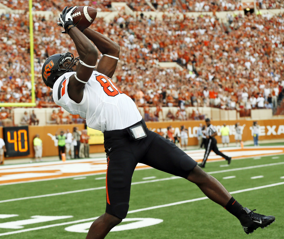 Oklahoma State's Jhajuan Seales (81) makes a catch in the second quarter during a college football game between the Oklahoma State University Cowboys (OSU) and the University of Texas Longhorns (UT) at Darrell K Royal - Texas Memorial Stadium in Austin, Texas, Saturday, Nov. 16, 2013. Photo by Nate Billings, The Oklahoman