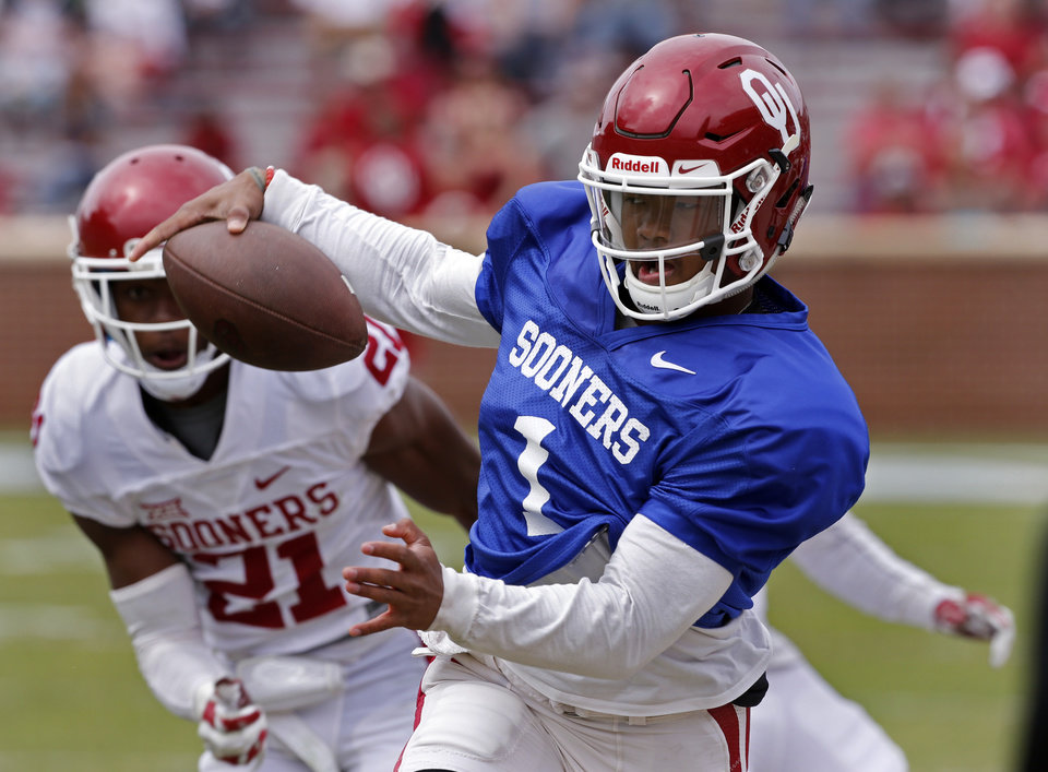 Photo - Quarterback Kyler Murray tries to stay in bounds on a run during the spring football game at the University of Oklahoma (OU) at Gaylord Family-Oklahoma Memorial Stadium in Norman, Okla., on  Saturday, April 9, 2016. Photo by Steve Sisney, The Oklahoman