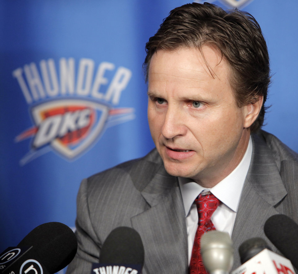 Photo - Head coach Scott Brooks speaks to the media during media day for the Oklahoma City Thunder at the Ford Center in downtown Oklahoma City, Monday, Sept. 27, 2010. Photo by Nate Billings, The Oklahoman