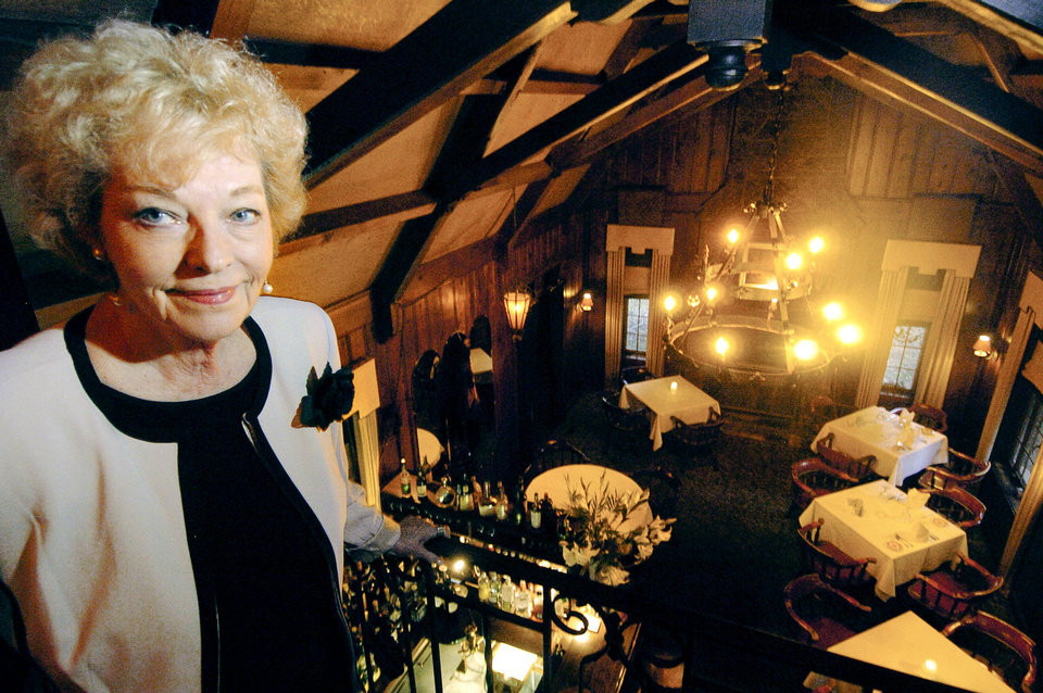 Marian Thibault, owner of Haunted House Restaurant in northeast Oklahoma City, stands on a balcony in 2006 overloooking one of the dining rooms in the former residence. Oklahoman Archive photo <strong>MICHAEL DOWNES - THE OKLAHOMAN</strong>