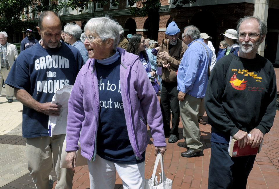 Photo - Anti-nuclear weapons activists, from left, Michael Walli, 64, Sister Megan Rice, 83, and Greg Boertje-Obed, 56, arrive for their trial on Monday, May 6, 2013, in Knoxville, Tenn. The activists, who call themselves