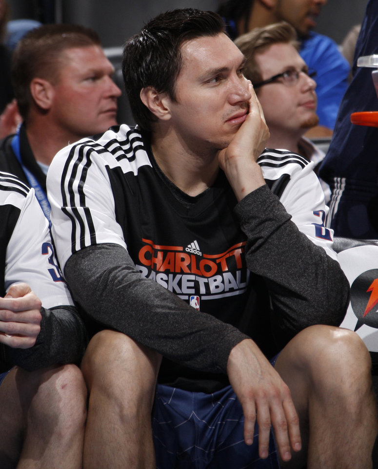 Photo - Charlotte's Eduardo Najera (21)  watches from the bench during an NBA basketball game between the Oklahoma City Thunder and the Charlotte Bobcats at the Oklahoma City Arena, Friday, March 18, 2011. Photo by Bryan Terry, The Oklahoman