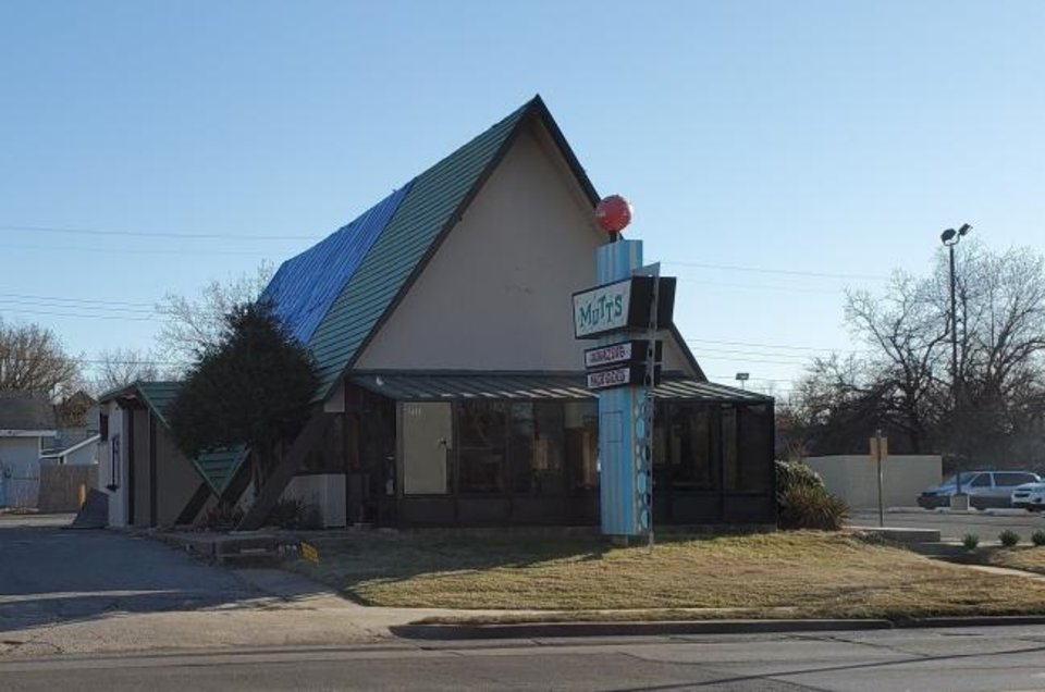 Photo -  The new owner of Mutt's, damaged by a tornado last year, is hoping to tear it down and replace it with a strip shopping center. [Steve Lackmeyer, The Oklahoman]