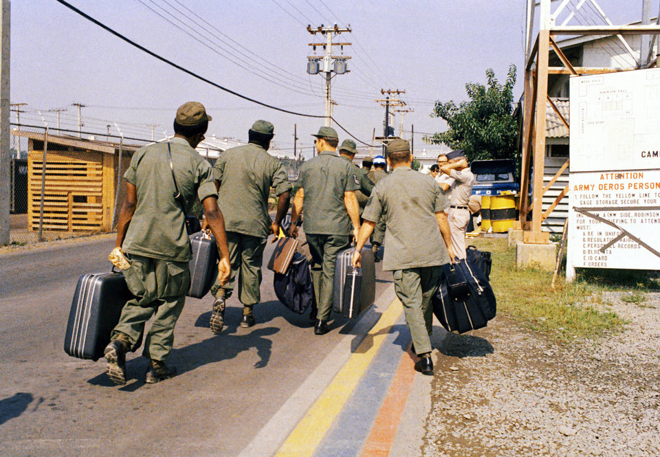 In this March 29, 1973 photo, Camp Alpha, Uncle Sam's out processing center, was chaos in Saigon. Lines of bored soldiers snaked through customs and briefing rooms. As the last U.S. combat troops left Vietnam 40 years ago, angry protesters still awaited them at home. North Vietnamese soldiers took heart from their foes' departure, and South Vietnamese who had helped the Americans feared for the future. While the fall of Saigon two years later — with its indelible images of frantic helicopter evacuations — is remembered as the final day of the Vietnam War, Friday marks an anniversary that holds greater meaning for many who fought, protested or otherwise lived it.  (AP Photo)