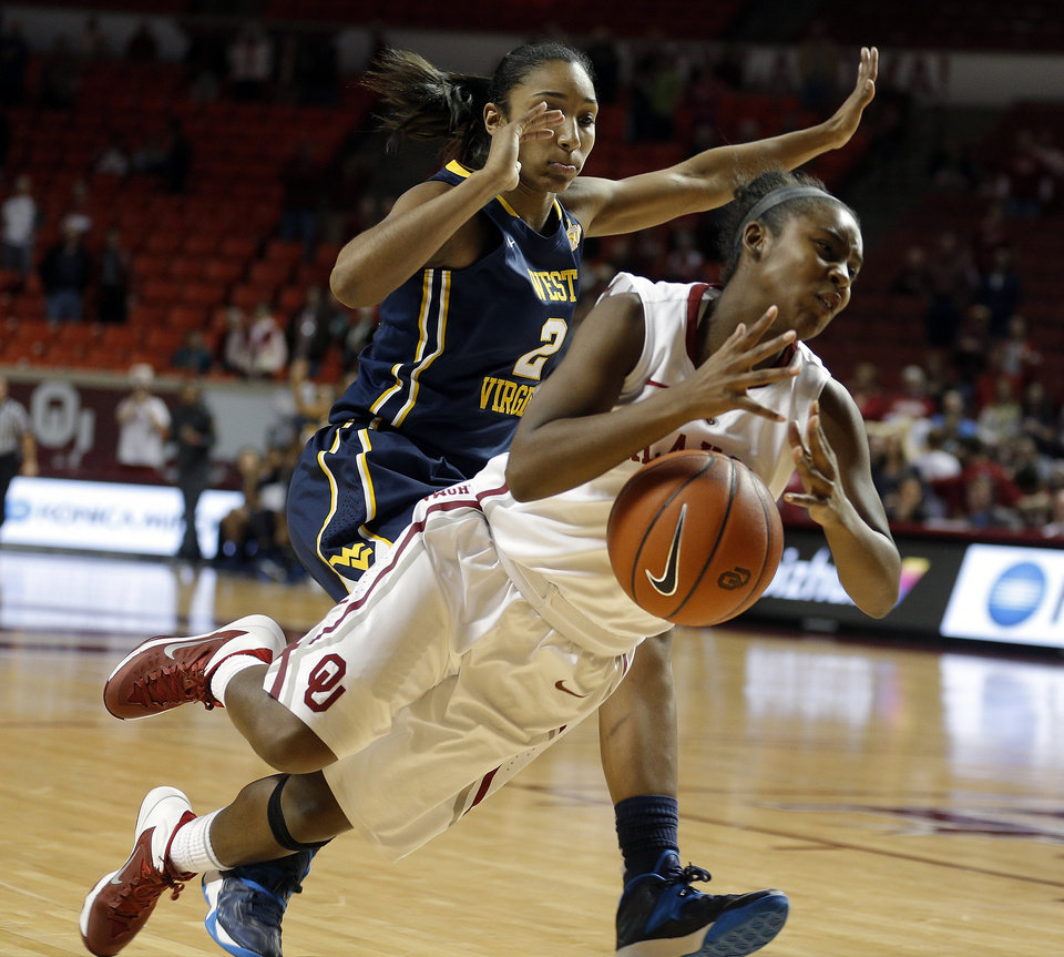 Photo - Oklahoma guard T'ona Edwards (2) is fouled by West Virginia guard Taylor Palmer (2) in the final seconds of  the women's basketball game between, University of Oklahoma and West Virginia, Thursday, Feb. 13, 2014, in Norman, Okla. Photo by Sarah Phipps, The Oklahoman