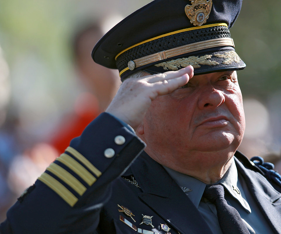 Oklahoma City Police Department Chaplain Jack Poe salutes during the National Anthem during the 16th Annual Day of Remembrance at the Oklahoma City National Memorial and Museum in Oklahoma City, Oklahoma onTuesday, April 19, 2011. Photo by John Clanton, The Oklahoman