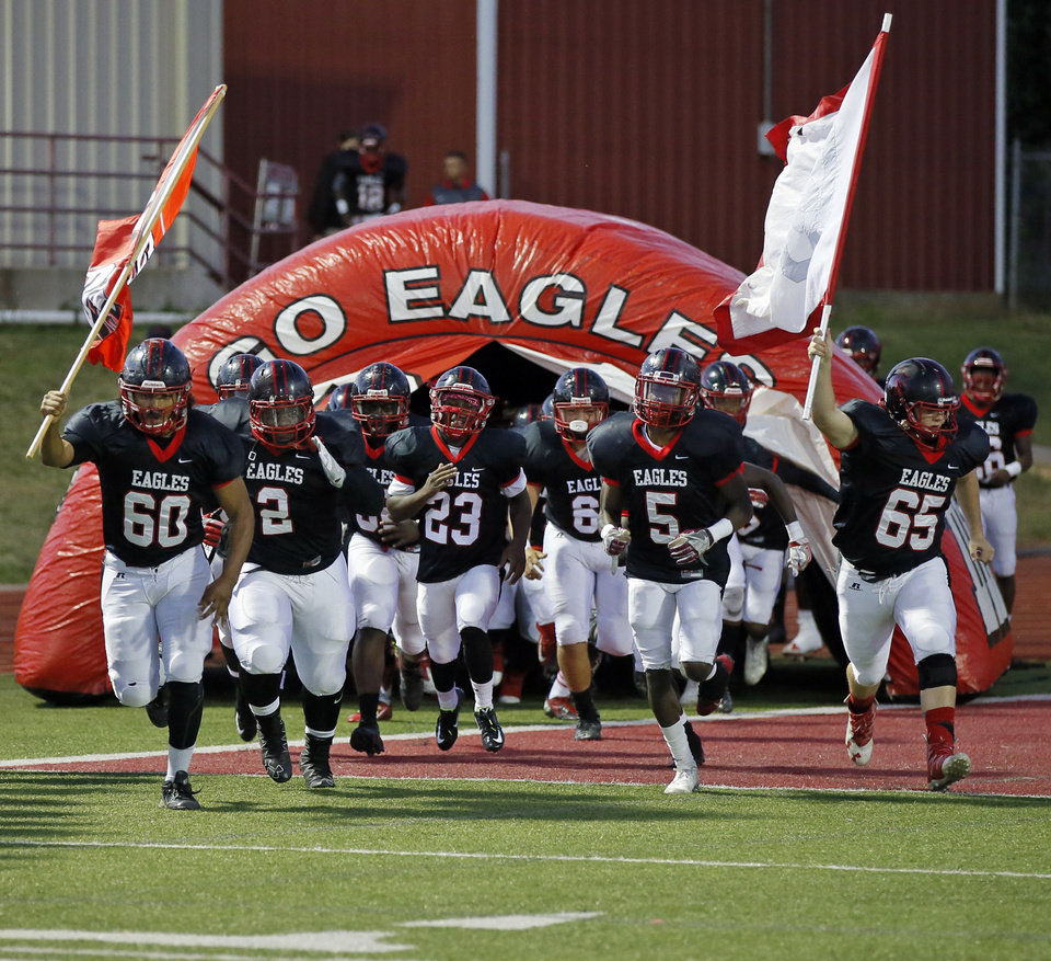 Photo - The Del City Eagles take the field before a high school football game between Del City and Ardmore in Del City, Okla., Thursday, Oct. 20, 2016. Photo by Nate Billings, The Oklahoman