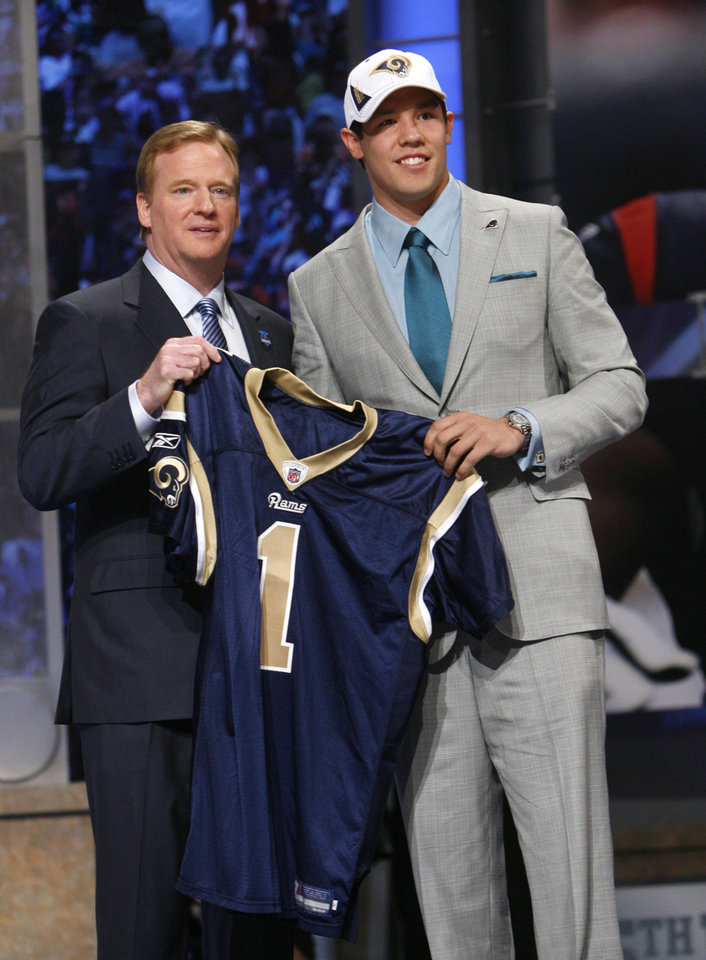Photo - Oklahoma quarterback Sam Bradford, right, holds up a jersey with NFL commissioner Roger Goodell after he was selected as the No. 1 overall pick in the first round of the NFL Draft by the St. Louis Rams Thursday, April 22, 2010, at Radio City Music Hall in New York. (AP Photo/Jason DeCrow)