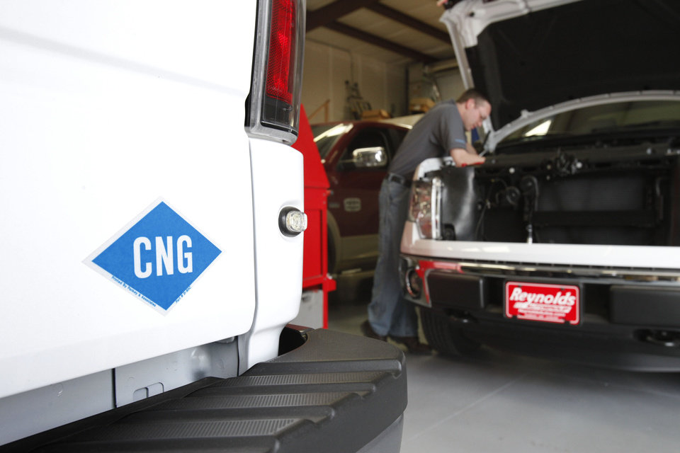 Photo - Trucks are being converted to compressed natural gas at CNG Interstate in Oklahoma City.