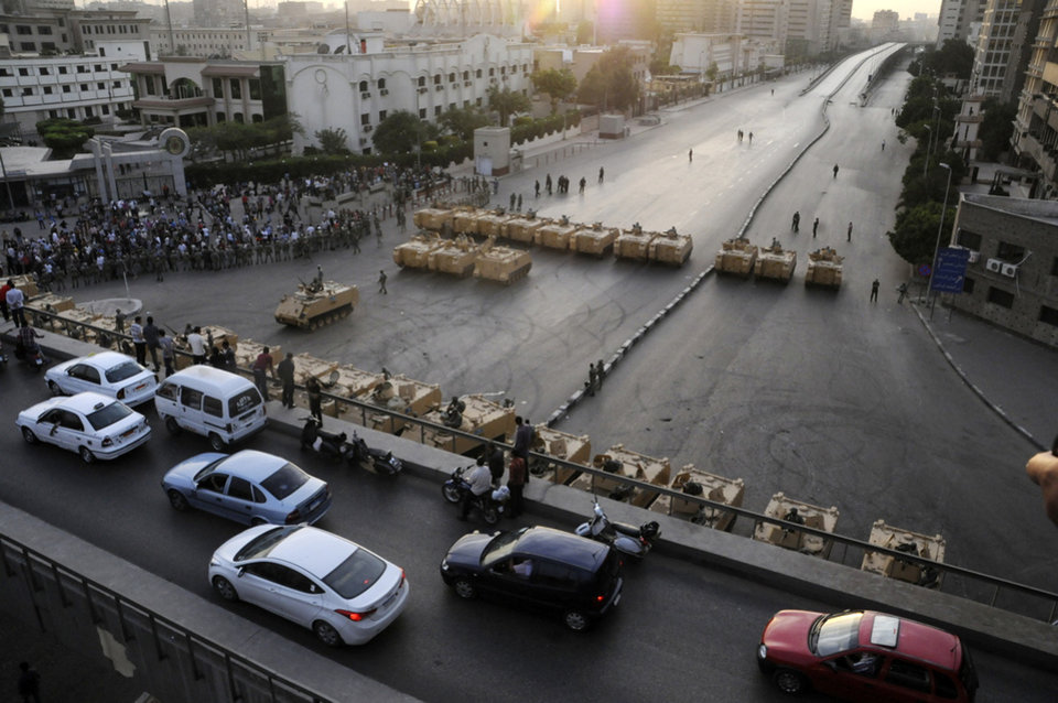 Photo -   Armored Egyptian military vehicles block the road outside of the Ministry of Defense in Cairo, Egypt, Friday, May 4, 2012. Egyptian armed forces and protesters clashed in Cairo on Friday, with troops firing water cannons and tear gas at demonstrators who threw stones as they tried to march on the Defense Ministry, a flashpoint for a new cycle of violence only weeks ahead of presidential elections.(AP Photo/Ahmad Hammad)