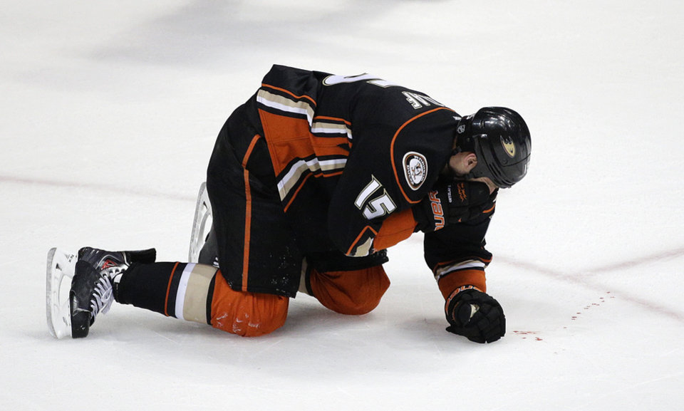 Photo - Anaheim Ducks' Ryan Getzlaf bleeds after he was hit in the face by a puck during the third period in Game 1 of the first-round NHL hockey Stanley Cup playoff series against the Dallas Stars on Wednesday, April 16, 2014, in Anaheim, Calif. The Ducks won 4-3. (AP Photo/Jae C. Hong)