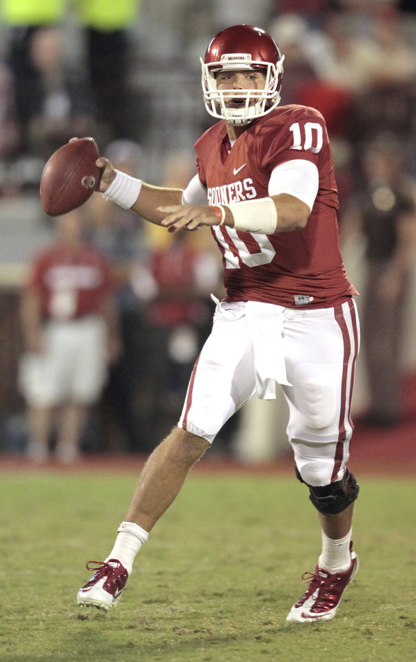 Oklahoma Sooners' Blake Bell (10) passes during the second half of the college football game in which the University of Oklahoma Sooners (OU) defeated the Ball State Cardinals 62-6 at Gaylord Family-Oklahoma Memorial Stadium on Saturday, Oct. 1, 2011, in Norman, Okla. Photo by Steve Sisney, The Oklahoman