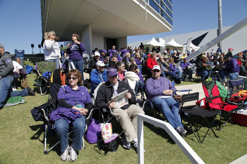 Photo - Spectators watch the Oklahoma Regatta Festival on the Oklahoma River in front of the finish line in Oklahoma City, OK, Saturday, October 5, 2013,  Photo by Paul Hellstern, The Oklahoman