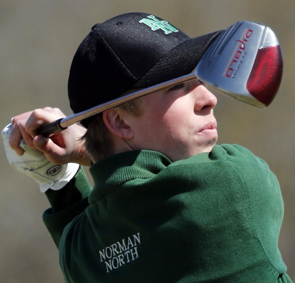 Photo - Norman North golfer Thomas Ludwig hits during the Norman North Invitational Golf Tournament at the Jimmie Austin Golf Club on Tuesday, March 26, 2013, in Norman, Okla.   Photo by Steve Sisney, The Oklahoman