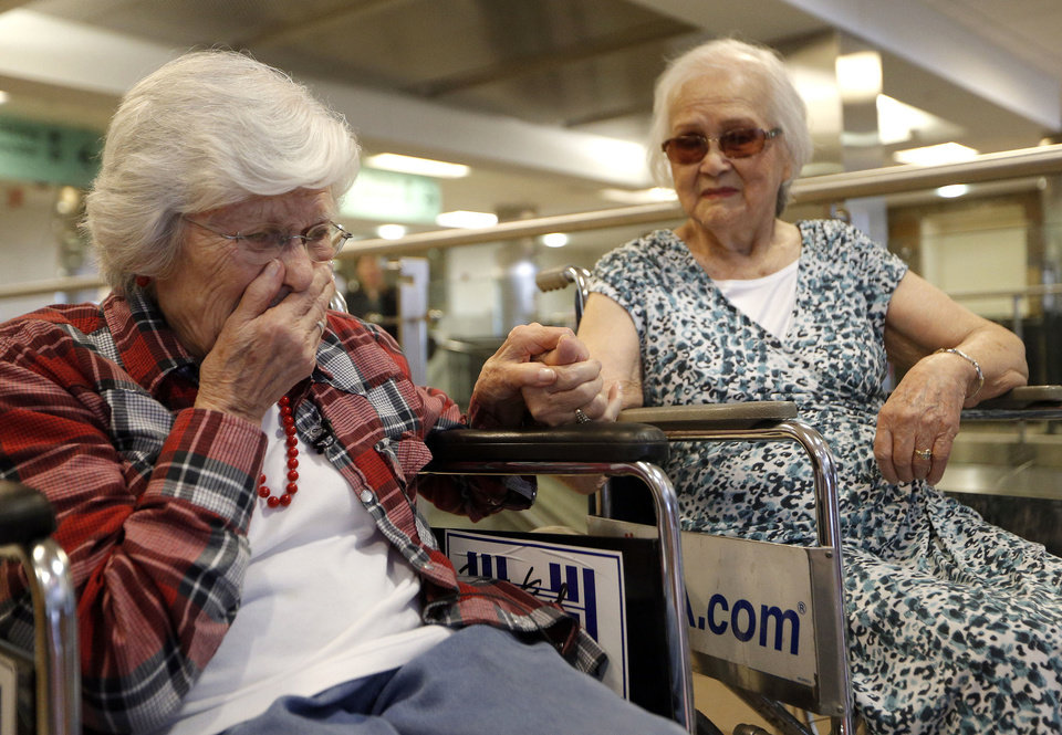 Photo - Sadie Fanali is overcome with emotion after meeting Lorraine Thomas for the first time at Will Roger World Airport, Friday, June 14, 2013, in Oklahoma City.  The pair have been pen pals since 1932. Photo by Sarah Phipps, The Oklahoman