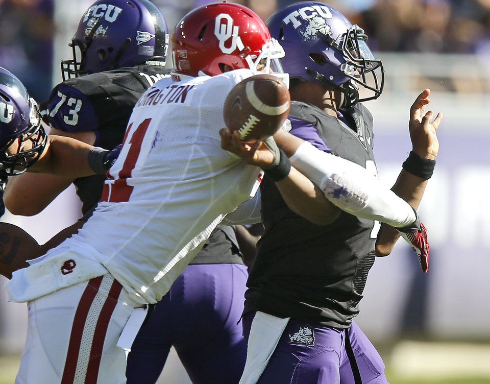 Photo - Oklahoma's R.J. Washington (11) forces TCU's Trevone Boykin (2) to fumble during a college football game between the University of Oklahoma Sooners (OU) and the Texas Christian University Horned Frogs (TCU) at Amon G. Carter Stadium in Fort Worth, Texas, Saturday, Dec. 1, 2012. Oklahoma won 24-17. Photo by Bryan Terry, The Oklahoman