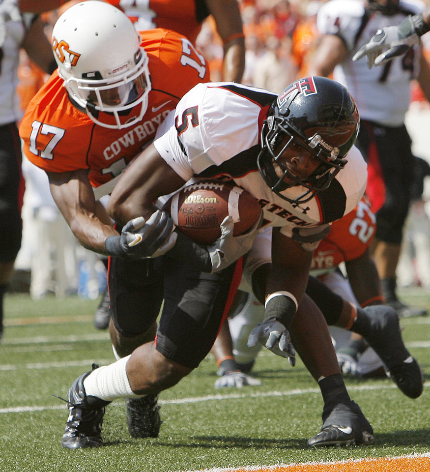 Texas Tech's Michael Crabtree (5) makes his way past Oklahoma State's Jacob Lacey (17) for a touchdown during the first half of the college football game between the Oklahoma State University Cowboys (OSU) and the Texas Tech University Red Raiders (TTU) at Boone Pickens Stadium in Stilllwater, Okla., on Saturday, Sept. 22, 2007.