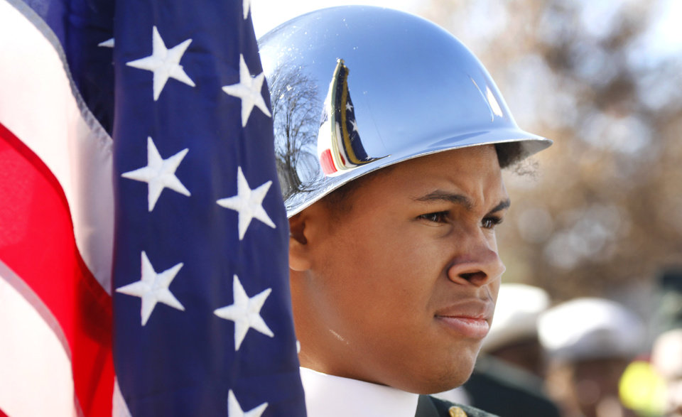 Payton Parham, JROTC member at Northeast High School waits for the start of the Martin Luther King Jr. Parade in Oklahoma City, Monday January 20, 2014. Photo By Steve Gooch, The Oklahoman
