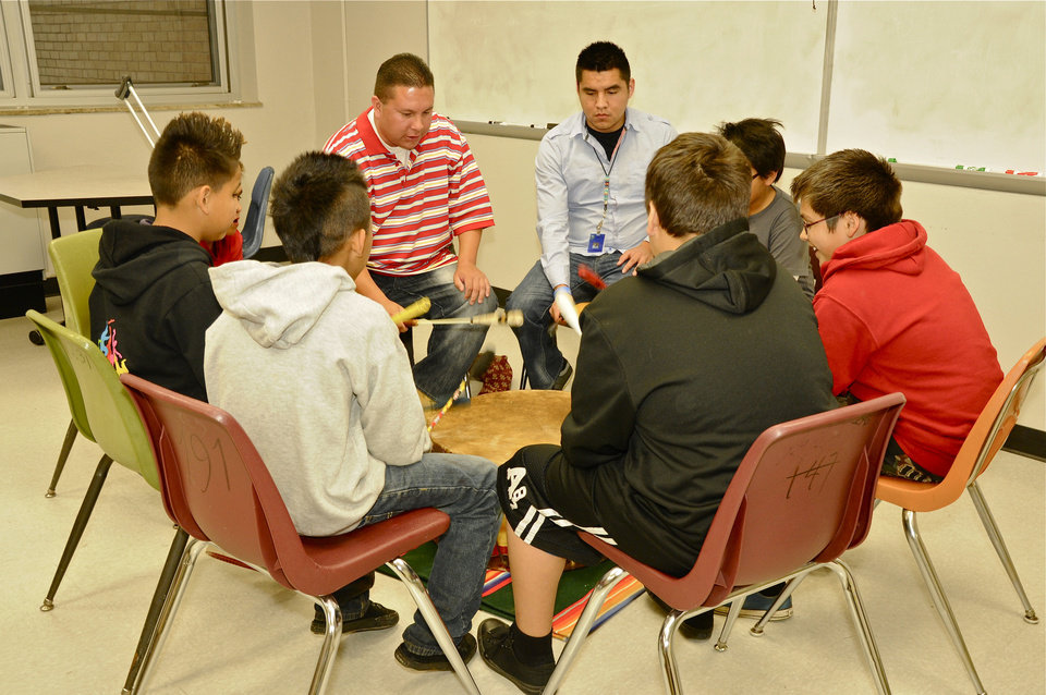Photo - Mike Kihega and Taylor Mann teach drumming skills to American Indian youth.