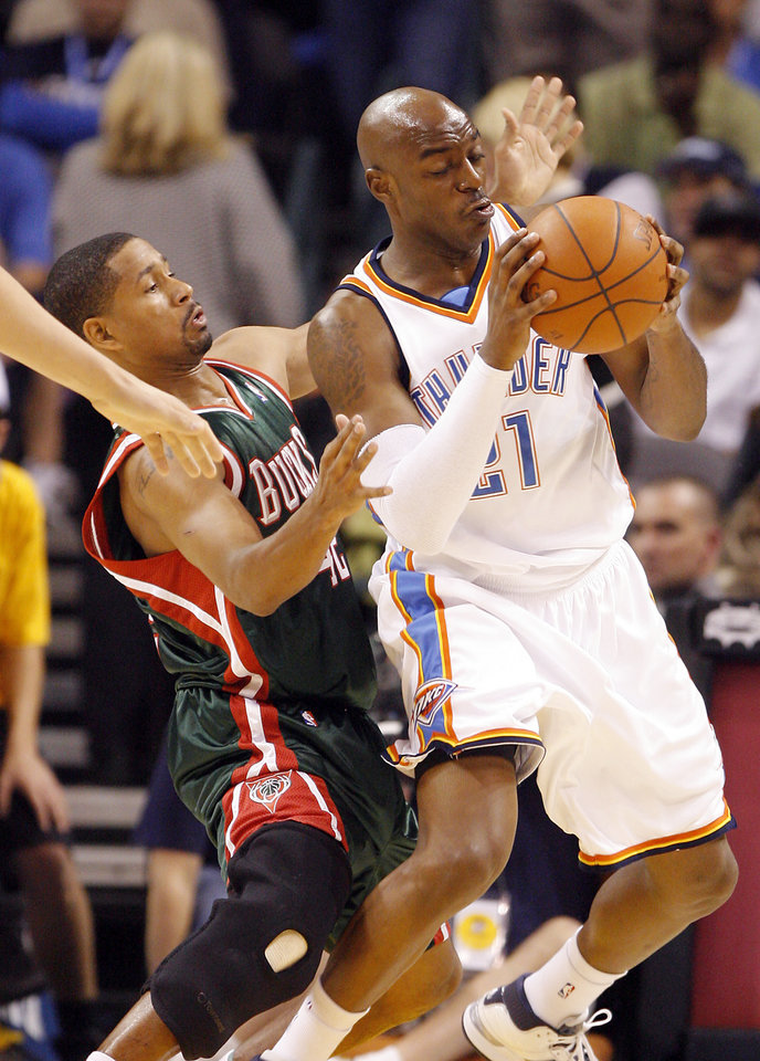 The Bucks' Charlie Bell (42) defends on Damien Wilkins (21) of the Thunder during the opening NBA basketball game between the Oklahoma City Thunder and the Milwaukee Bucks at the Ford Center in Oklahoma City, Wednesday, October 29, 2008.  BY BRYAN TERRY, THE OKLAHOMAN