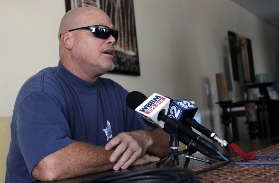 Photo - Former NFL football quarterback Jim McMahon speaks during a news conference Tuesday, June 17, 2014 in Chicago.  McMahon spoke of his ongoing battle with dementia that he believe is related to his years of hits he took while playing in the league. McMahon is part of a federal lawsuit filed in San Francisco accusing teams of illegally dispensing powerful narcotics and other drugs to keep players on the field without regard for their long-term health. He led the Chicago Bears to victory in the 1985 Super Bowl. (AP Photo/Stacy Thacker)