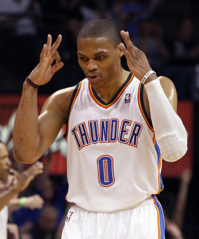 NBA BASKETBALL / BASKETBALL / OKC THUNDER / NY KNICKS / CHESAPEAKE ENERGY ARENA / OKC: Oklahoma City\'s Russell Westbrook (0) celebrates a three-point shot during NBA basketball game between the Oklahoma City Thunder and the New York Knicks at the Chesapeake Energy Arena, Sunday, April 7, 2013, in Oklahoma City. Photo by Sarah Phipps, The Oklahoman.