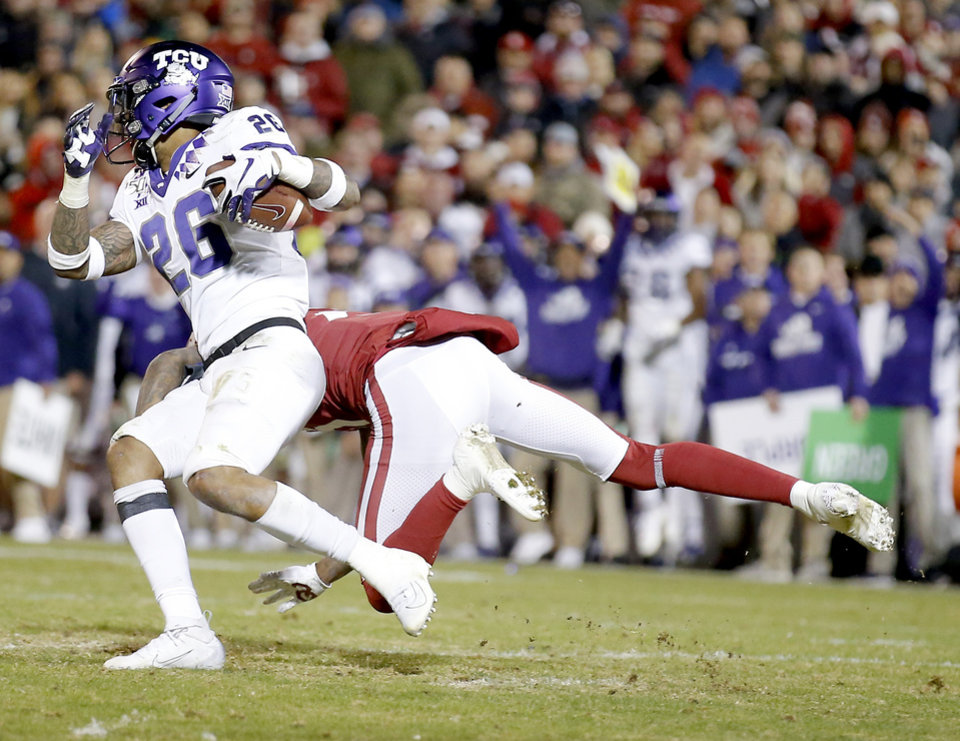 Photo - TCU's Vernon Scott (26) intercepts a Oklahoma's Jalen Hurts (1) pass for a 98- yard pick 6 during an NCAA football game between the University of Oklahoma Sooners (OU) and the TCU Horned Frogs at Gaylord Family-Oklahoma Memorial Stadium in Norman, Okla., Saturday, Nov. 23, 2019. OU won 28-24. [Sarah Phipps/The Oklahoman]