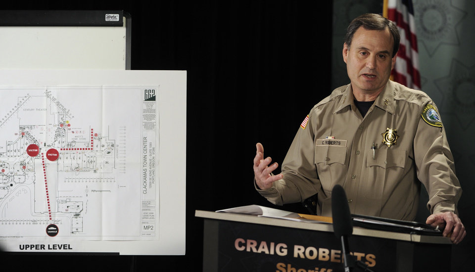 Photo - Clackamas County Sherriff Craig Roberts speaks at a press conference  Wednesday Dec. 12, 2012, about the multiple shooting Tuesday at Clackamas Town Center Mall in Portland, Ore.  Jacob Tyler Roberts killed two people and himself in the shooting rampage.  (AP Photo/Greg Wahl-Stephens)