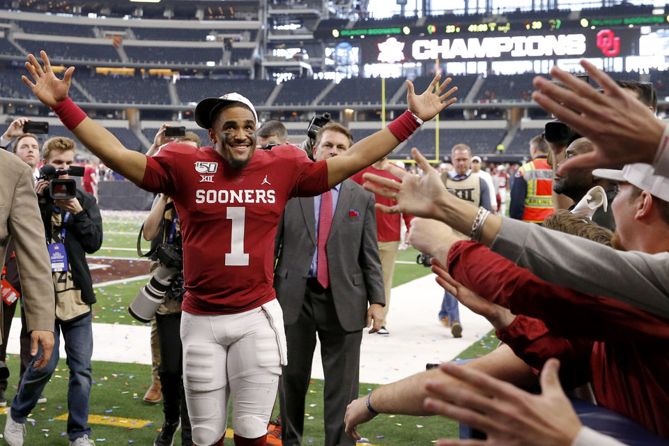 Photo - Oklahoma's Jalen Hurts (1) celebrates with fans after the Big 12 Championship Game between the University of Oklahoma Sooners (OU) and the Baylor University Bears at AT&T Stadium in Arlington, Texas, Saturday, Dec. 7, 2019. Oklahoma won 30-23. [Bryan Terry/The Oklahoman]