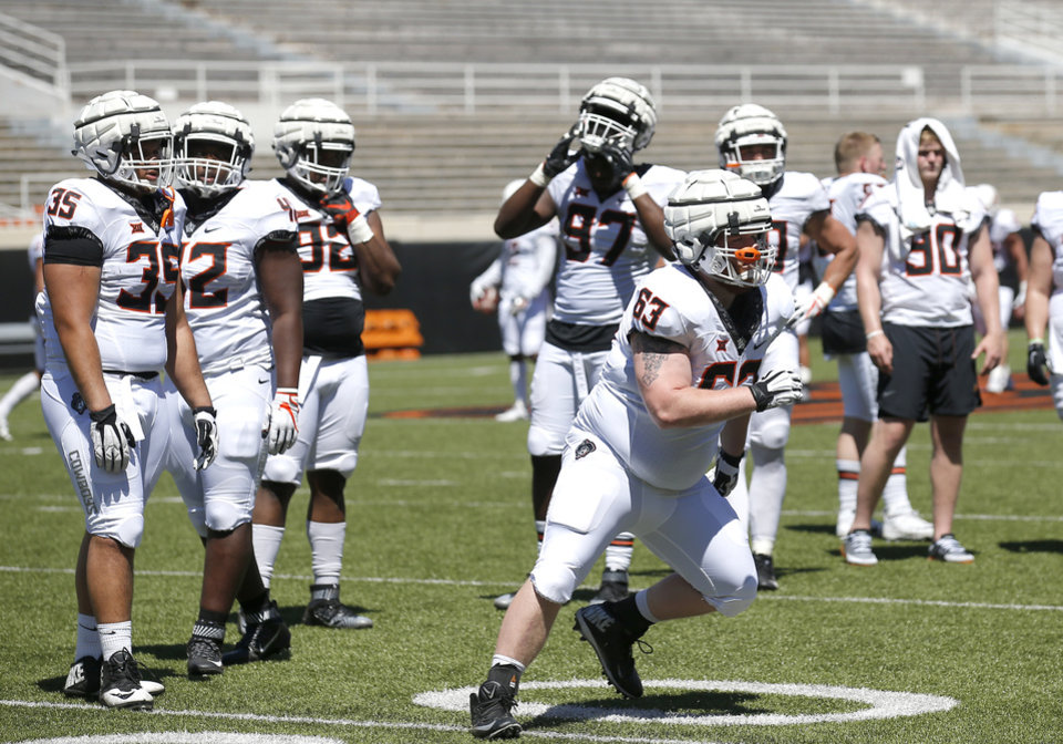 Photo - Oklahoma State's Dylan Carnagey (63) runs through a drill during the Oklahoma State Cowboys spring practice at Boone Pickens Stadium in Stillwater, Okla., Saturday, April 20, 2019.  Photo by Sarah Phipps, The Oklahoman