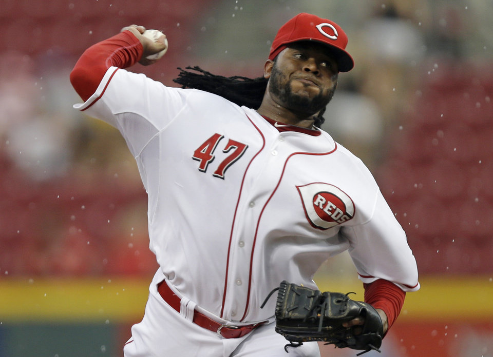 Photo - Cincinnati Reds starting pitcher Johnny Cueto throws against the Chicago Cubs in the first inning of a baseball game, Tuesday, Aug. 26, 2014, in Cincinnati. (AP Photo/Al Behrman)