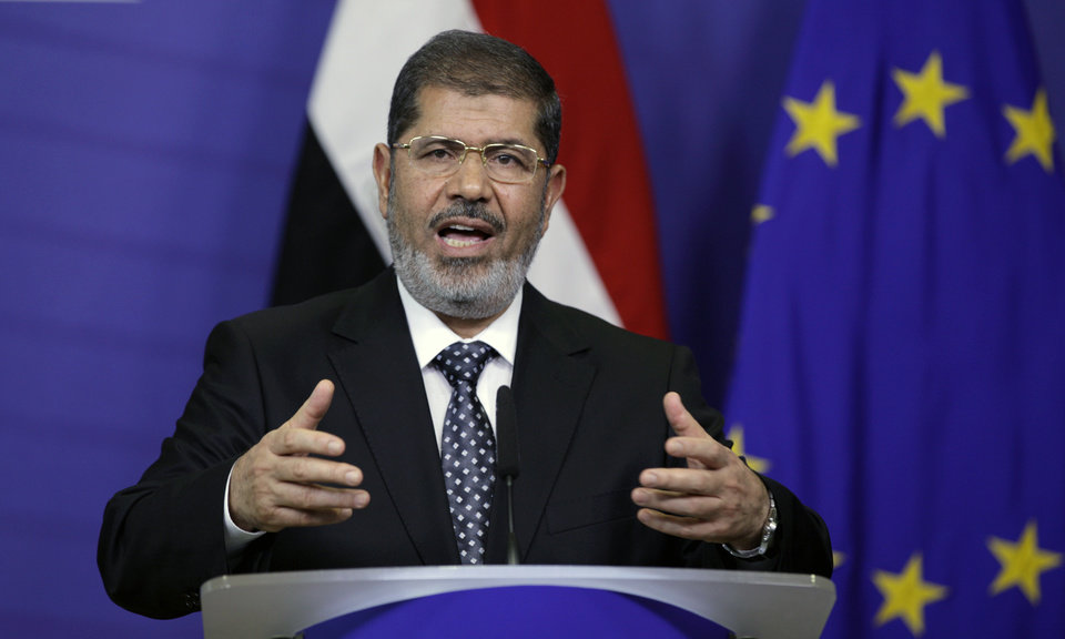 Photo -   Egyptian President Mohamed Morsi gestures while speaking during a media conference at EU headquarters in Brussels on Thursday, Sept. 13, 2012. This is Egyptian President Mohammed Morsi's first trip to the European Union since being elected president. (AP Photo/Virginia Mayo)