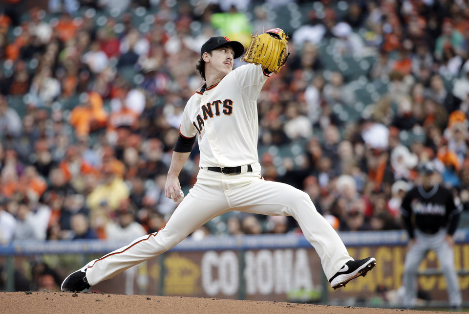Photo - San Francisco Giants starting pitcher Tim Lincecum throws to the Miami Marlins during the first inning of a baseball game on Saturday, May 17, 2014, in San Francisco. (AP Photo/Marcio Jose Sanchez)