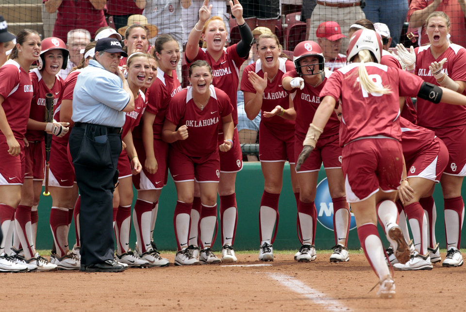 Photo - Sooner's celebrate catcher Jessica Shults home run in the fifth inning as the University of Oklahoma Sooner Softball team plays Arizona in game two of the NCAA Softball Norman Super Regional at Marita Hines field on Saturday, May 26, 2012, in Norman, Okla.  Photo by Steve Sisney, The Oklahoman