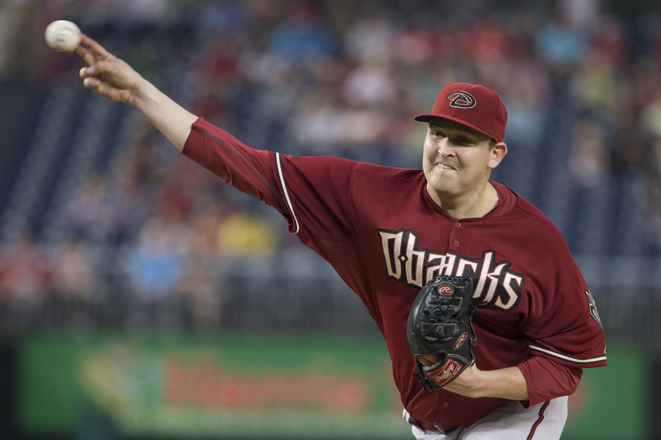 Photo - Arizona Diamondbacks starting pitcher Trevor Cahill delivers a pitch during the first inning of a baseball game against the Washington Nationals on Wednesday, Aug. 20, 2014, in Washington. (AP Photo/Evan Vucci)