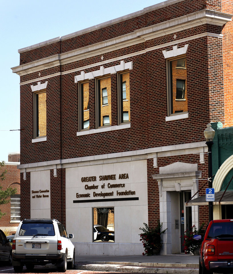 Photo - This building on the southeast corner of E 9tand Bell Street  in downtown Shawnee is the office of the Shawnee Chamber of Commerce and the Convention and Visitor Bureau.  Photo taken  Aug. 21,  2012.     Photo by Jim Beckel, The Oklahoman.  Jim Beckel