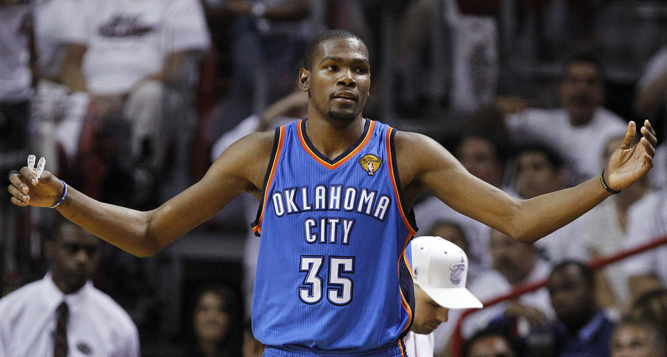 Oklahoma City Thunder small forward Kevin Durant (35) reacts against the Miami Heat during the second half at Game 3 of the NBA Finals basketball series, Sunday, June 17, 2012, in Miami. (AP Photo/Lynne Sladky) ORG XMIT: NBA144
