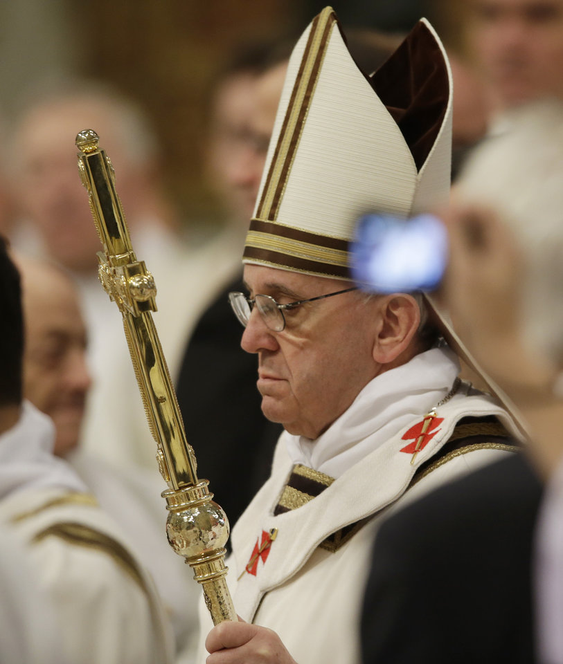 Pope Francis arrives for the Holy Thursday Mass that marks the start of four days of Easter celebrations, in St. Peter's Basilica at the Vatican, Thursday, March 28, 2013. (AP Photo/Gregorio Borgia)