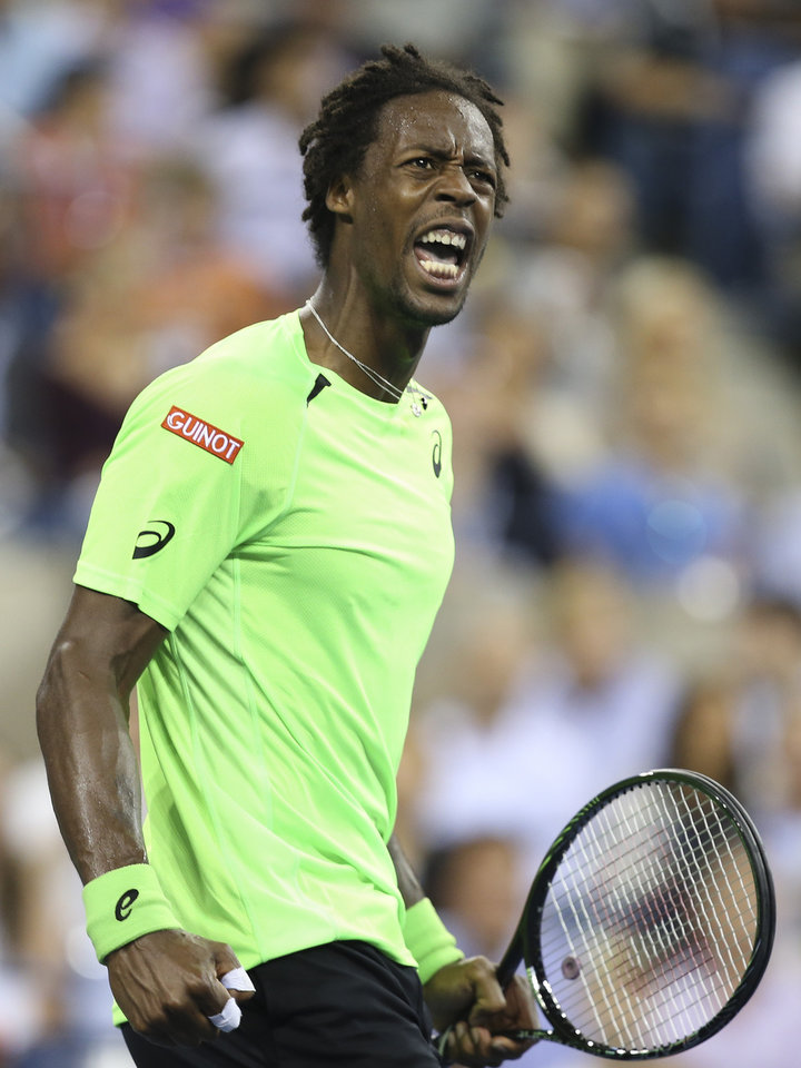 Photo - Gael Monfils, of France, reacts during a match against Roger Federer, of Switzerland, during the quarterfinals of the U.S. Open tennis tournament, Thursday, Sept. 4, 2014, in New York. (AP Photo/John Minchillo)