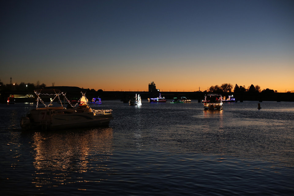 Boats gather during the Oklahoma River Boat Parade in Oklahoma City, Friday, Nov. 23, 2012.  Photo by Garett Fisbeck, The Oklahoman