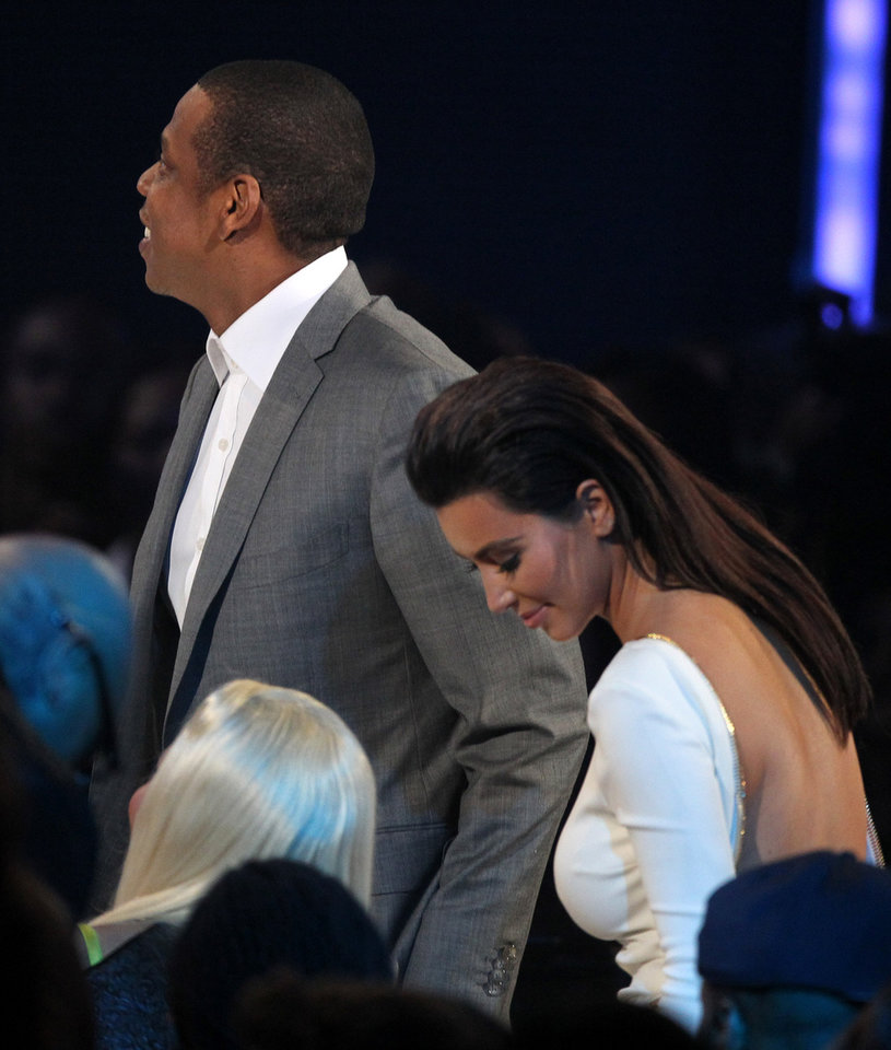 Photo -   Jay-Z, left, and Kim Kardashian are seen at the BET Awards on Sunday, July 1, 2012, in Los Angeles. (Photo by Matt Sayles/Invision/AP)