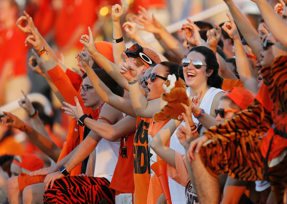 Norman fans raise their fingers for a kickoff during a high school football game between Moore and Norman in Moore, Okla., Thursday, Sept. 6, 2012. Photo by Nate Billings, The Oklahoman