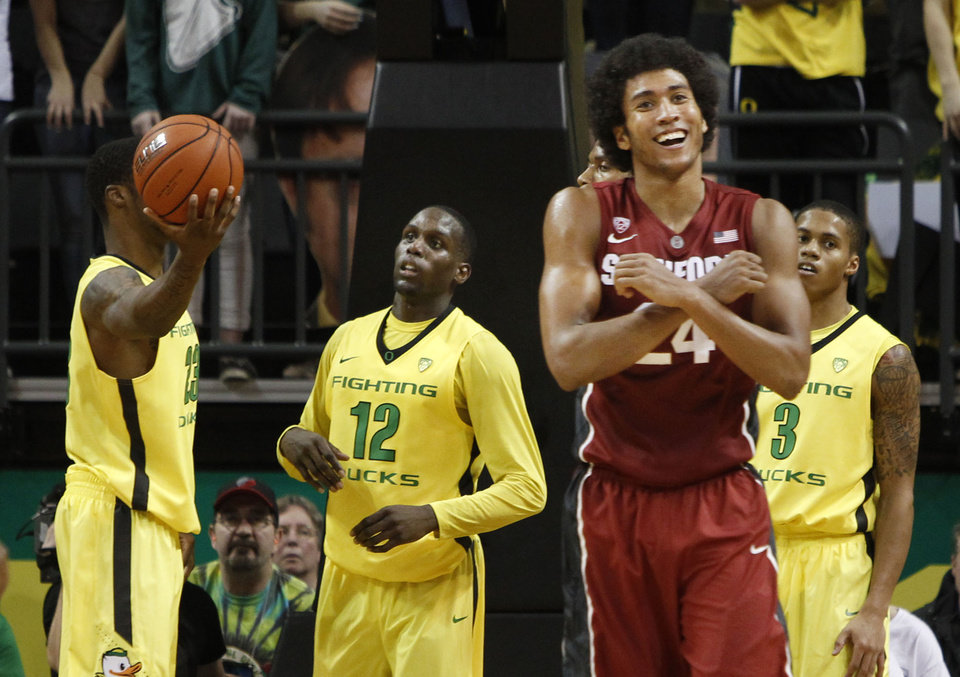 Photo - Stanford's Josh Huestis, second from right, celebrates an out-of-bounds call as Oregon's Elgin Cook, left, Jason Calliste and Joseph Young look on during the second half of an NCAA college basketball game in a  Eugene, Ore, on Sunday, Jan 12, 2014. (AP Photo/Chris Pietsch)