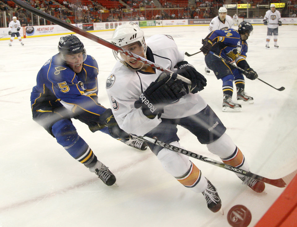 OKLAHOMA CITY BARONS / AHL HOCKEY: Oklahoma City's Tyler Pitlick chases down the puck in front of Peoria's David Shields during a Barons hockey game at the Cox Convention Center in Oklahoma City, Friday, April 6, 2012. Photo by Bryan Terry, The Oklahoman ORG XMIT: KOD