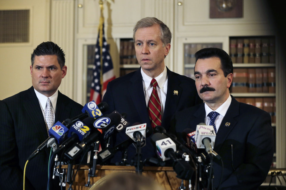 Photo - New Jersey Assemblymen John S. Wisniewski, center, D-Sayreville, N.J., Lou D. Greenwald, left, D-Vorhees, N.J., and incoming Assembly Speaker Vincent Prieto, D-Secaucus, N.J., address the media Monday, Jan. 13, 2014, in Trenton, N.J.  Greenwald,  says an investigation into massive local traffic jams that has ensnared Gov. Chris Christie's administration has grown into an abuse of power probe.  (AP Photo/Mel Evans)