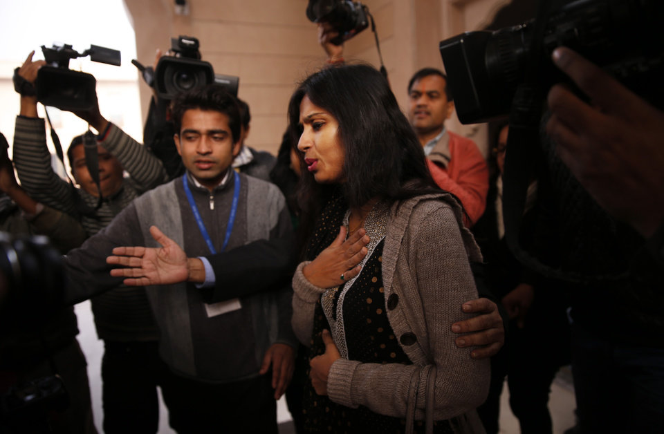 Photo - Devyani Khobragade, who served as India's deputy consul general in New York, reacts as she is questioned by journalists in New Delhi, India, Saturday, Jan. 11, 2014. Khobragade, 39, is accused of exploiting her Indian-born housekeeper and nanny, allegedly having her work more than 100 hours a week for low pay and lying about it on a visa form. Khobragade has maintained her innocence, and Indian officials have described her treatment as barbaric. (AP Photo/Saurabh Das)